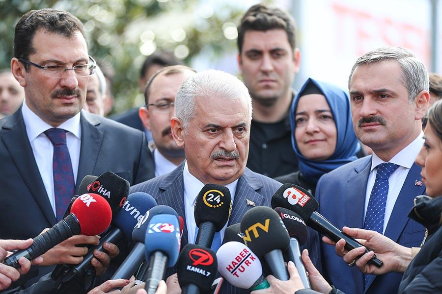 Istanbul mayoral candidate Binali Yildirim speaks to the press.