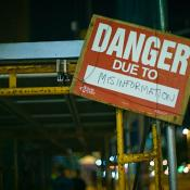 danger due to misinformation sign
